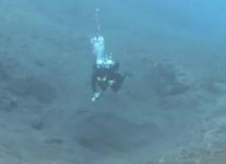 Diver Vanishing in Portal to Maya Underworld